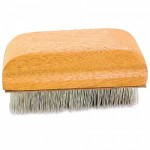 Upholstery brush used for grooming fine upholstery and fabric