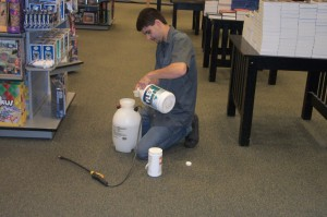 Carpet cleaning pre spray being mixed for commercial application