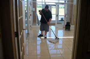 Wet mopping ice melt residue from lobby floor